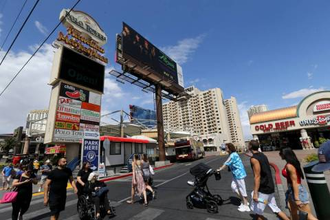 People walk on the Strip past the Hawaiian Marketplace Tuesday, May 22, 2018. A 16-acre piece o ...