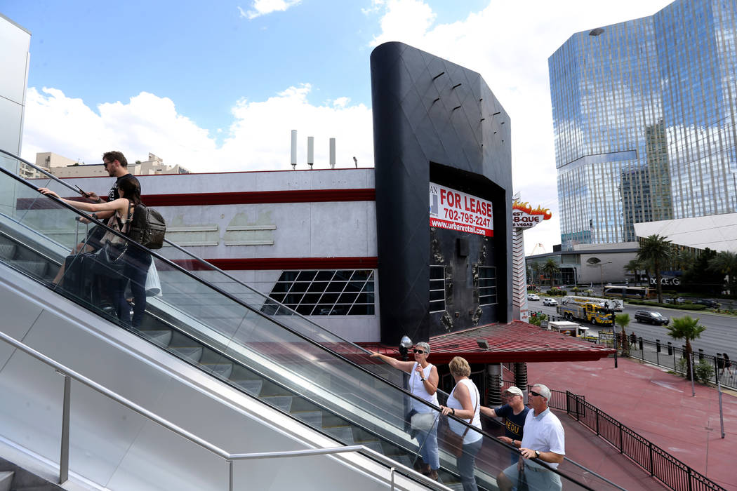 People take an escalator on the Strip near Harmon Avenue past a 16-acre piece of property that ...