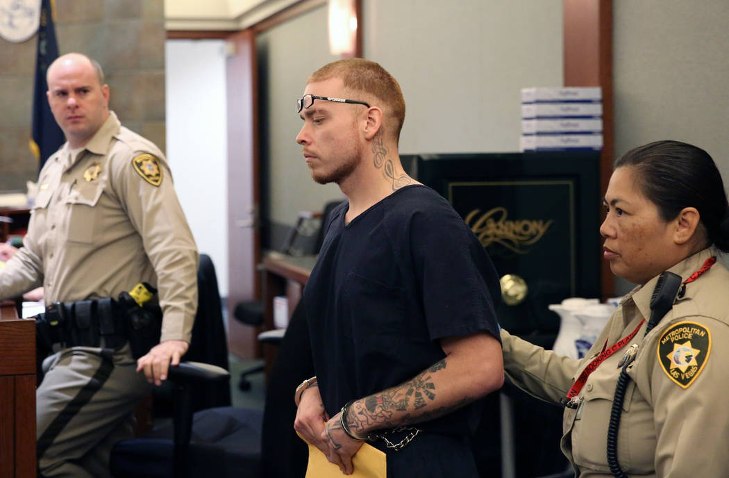Jon Kennison, 27, led into the courtroom at the Regional Justice Center in Las Vegas on Thursda ...