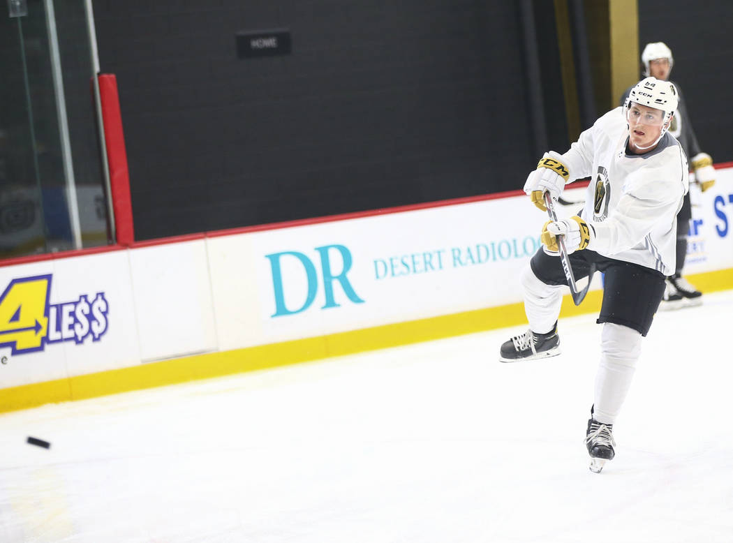 Golden Knights prostect Ben Jones (64) shoots the puck during the first day of development camp ...