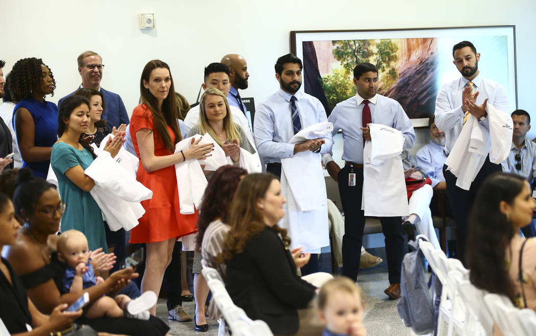 General surgery residents look on while participating in a white coat ceremony for Valley Healt ...