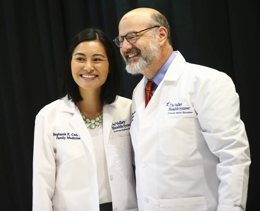 Family medicine resident Stephanie Cao, left, poses with Tom Hunt, family medicine program dire ...