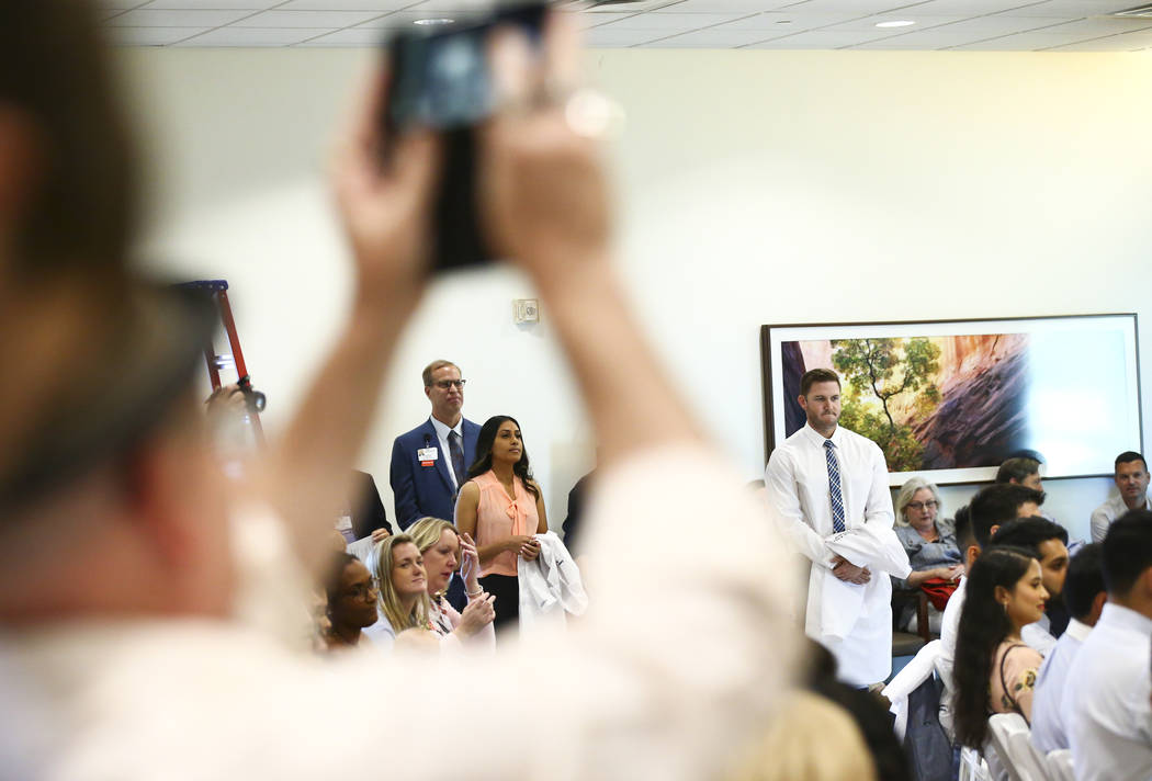 Family medicine resident Swetha Vakkalanka, center left, participates in a white coat ceremony ...