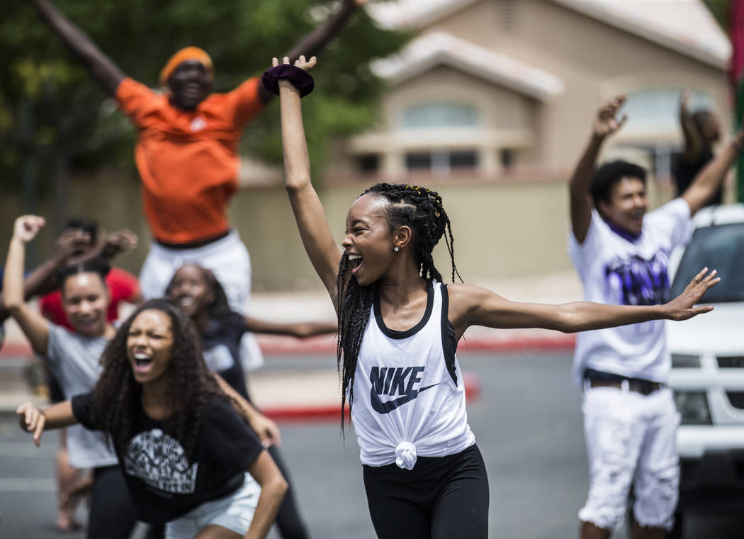 Jazmun McCoy, middle, dances with members of the West Las Vegas Arts Center Performance Ensembl ...