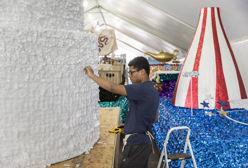 Dwight Jones works on a float during preparation for the Summerlin Patriotic Parade on Saturday ...