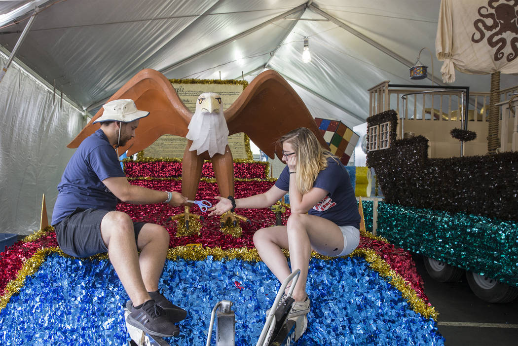 """Julien Mihy, left, and Jordyn Doyle put the finishing touches on a float titled """"Salute to ..."""