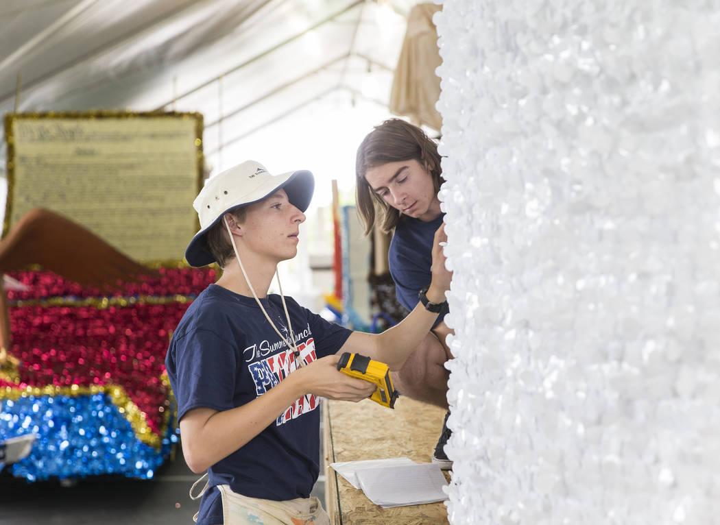 Connor Jordan, left, and Noah Jordan work on a float during preparation for the Summerlin Patri ...
