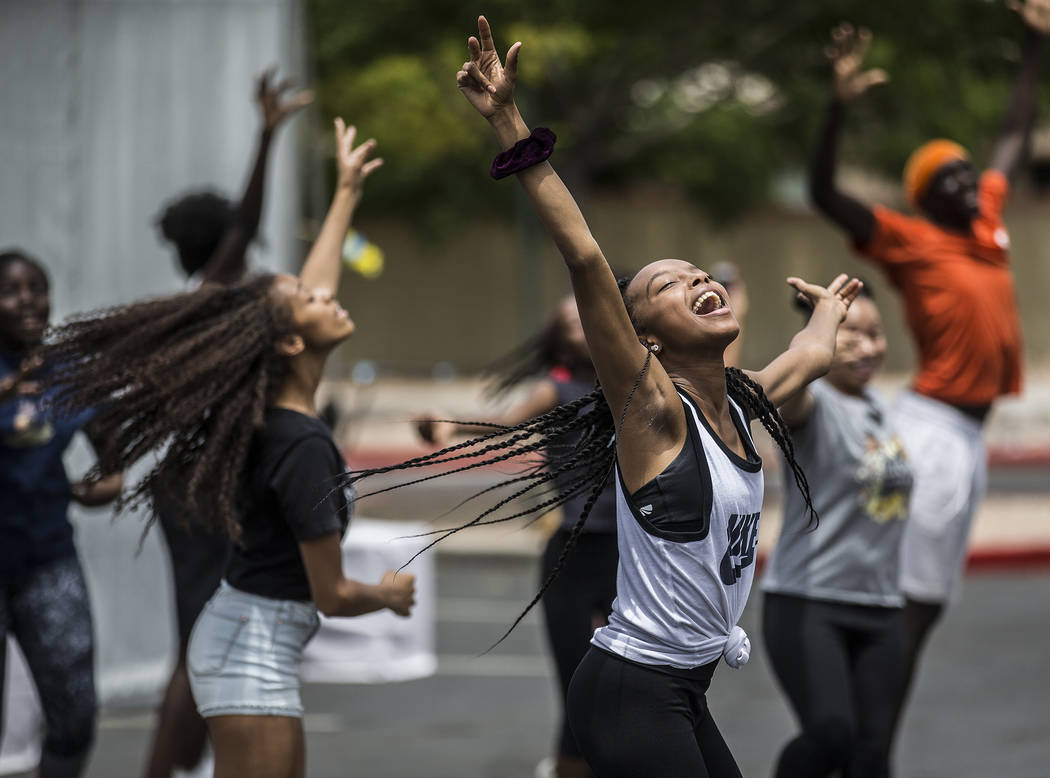 Jazmun McCoy, right, dances with members of the West Las Vegas Arts Center Performance Ensemble ...