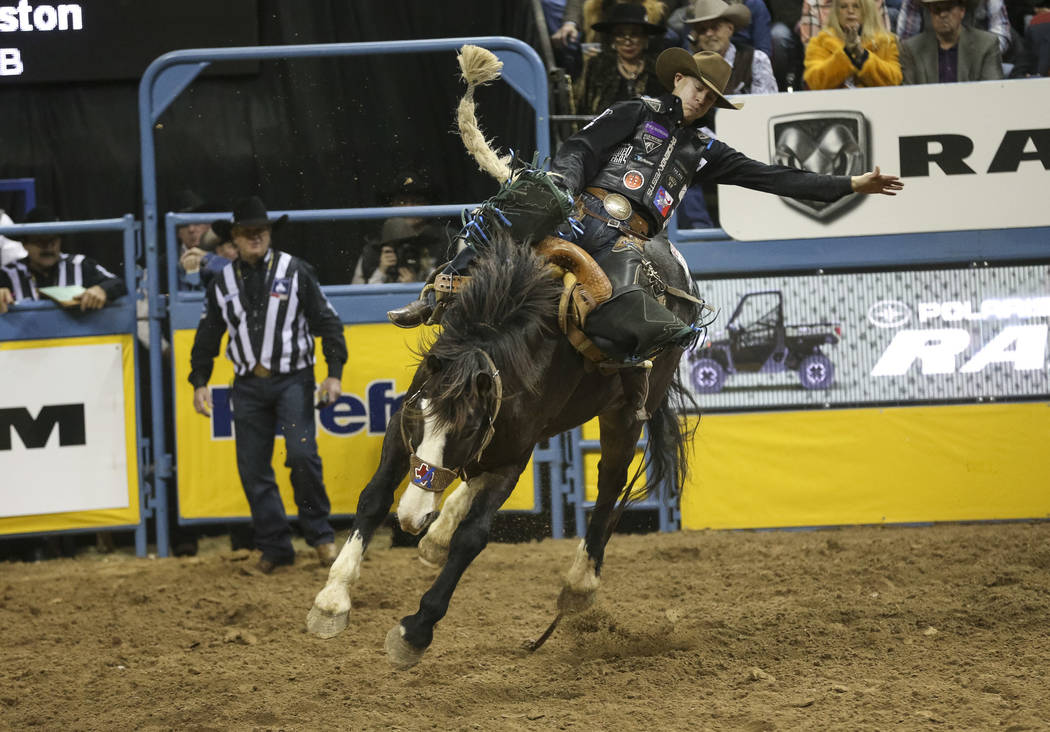 Zeke Thurston of Alberta, Canada (42) competes in the saddle bronc riding event during the nint ...
