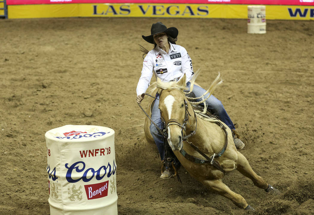 Hailey Kinsel of Cotulla, Texas (53) competes in the barrel racing event during the ninth go-ro ...