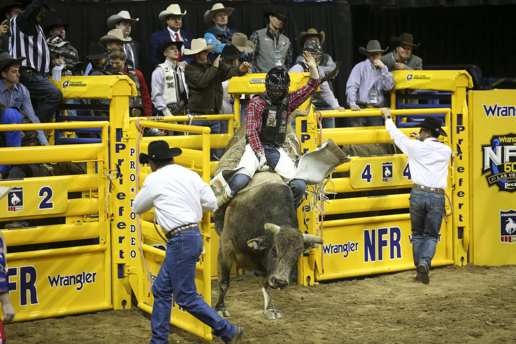 Eli Vastbinder of Union Grove, N.C. (105) competes in the bull riding event during the ninth go ...