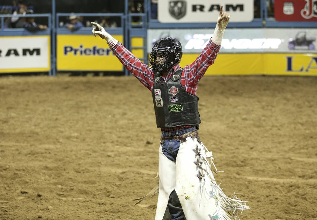 Eli Vastbinder of Union Grove, N.C. (105) reacts after competing in the bull riding event durin ...