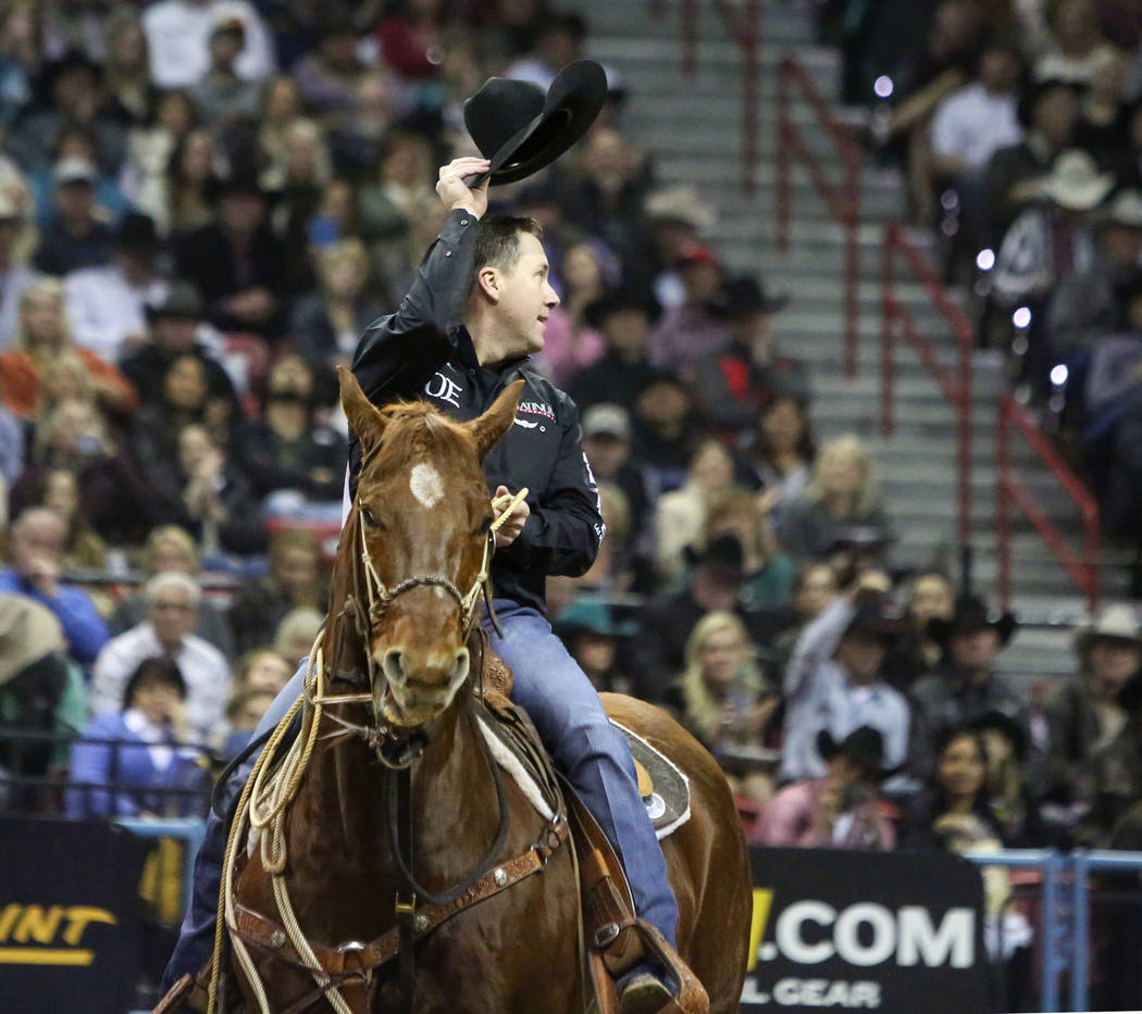 Trevor Brazile of Decatur, Texas (2) tips his hat after competing in tie-down roping during the ...