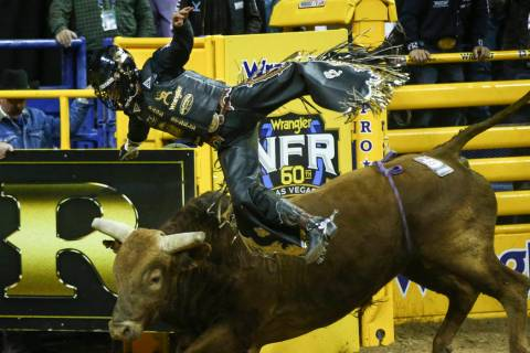 "Sage Kimzey of Strong City, Okla. gets upended by ""Mortimer"" after completing his bul ..."