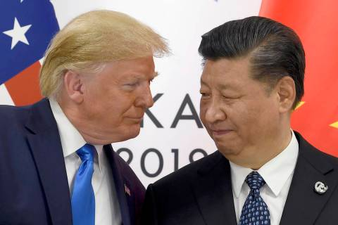 President Donald Trump, left, meets with Chinese President Xi Jinping during a meeting on the s ...