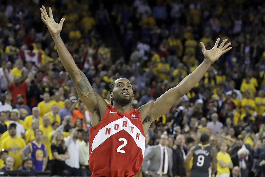 Toronto Raptors forward Kawhi Leonard celebrates after the Raptors defeated the Golden State Wa ...