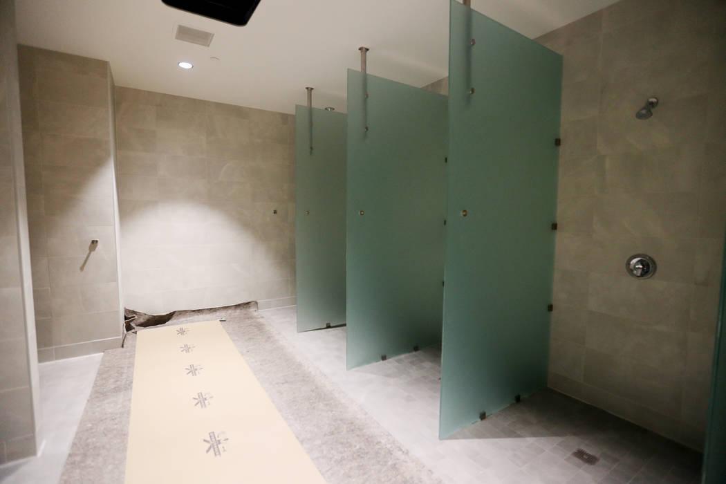 The showers for the locker room at the new UNLV Fertitta Football Complex, still under construc ...
