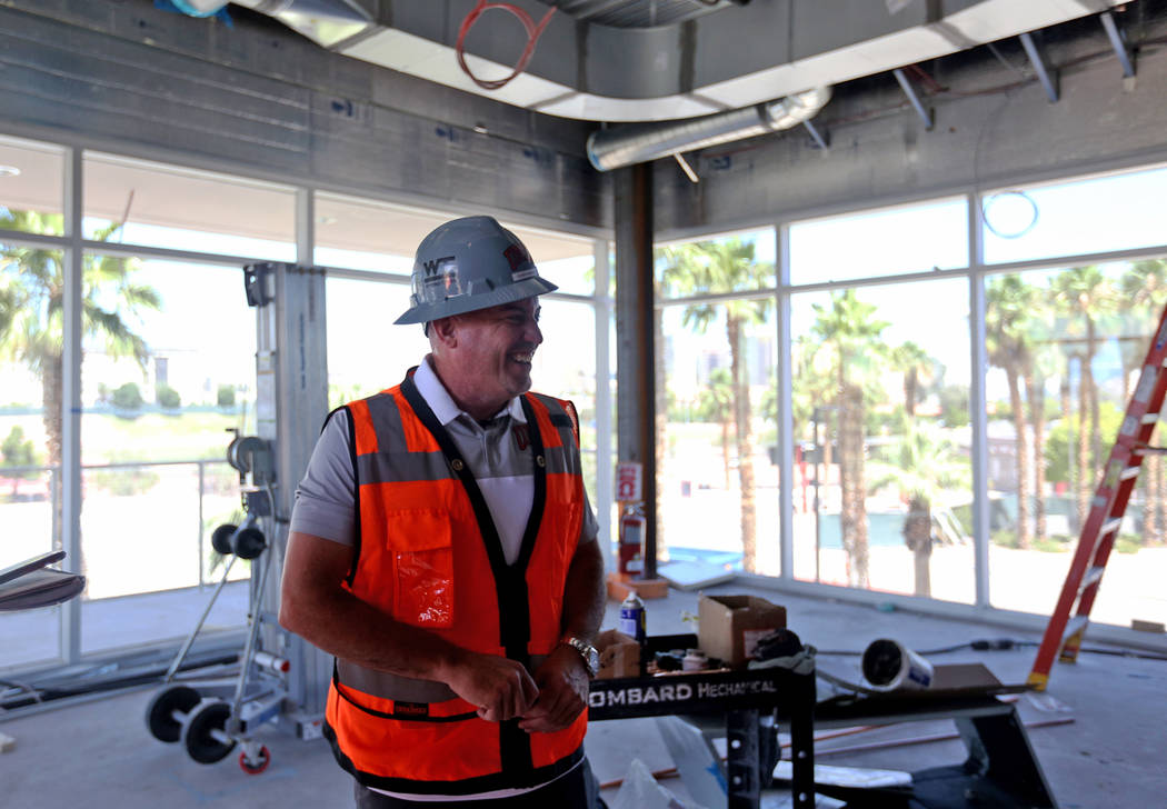 Coach Tony Sanchez leads a tour for the Review-Journal in his future office at the new UNLV Fer ...