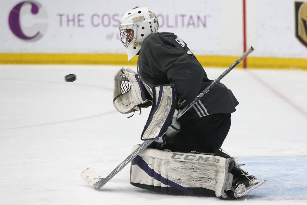 Vegas Golden Knights' Isaiah Saville makes a block during a development camp scrimmage at City ...