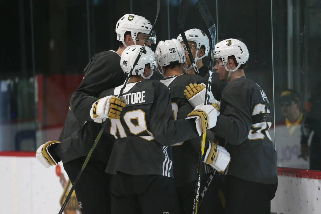 Players celebrate a goal by Vegas Golden Knights' Zak Smith during a development camp scrimmage ...