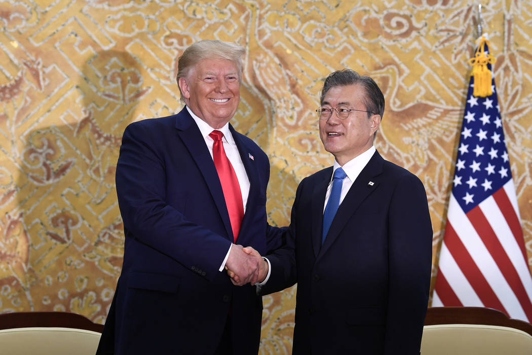 President Donald Trump and South Korean President Moon Jae-in shakes hands at the start of a bi ...
