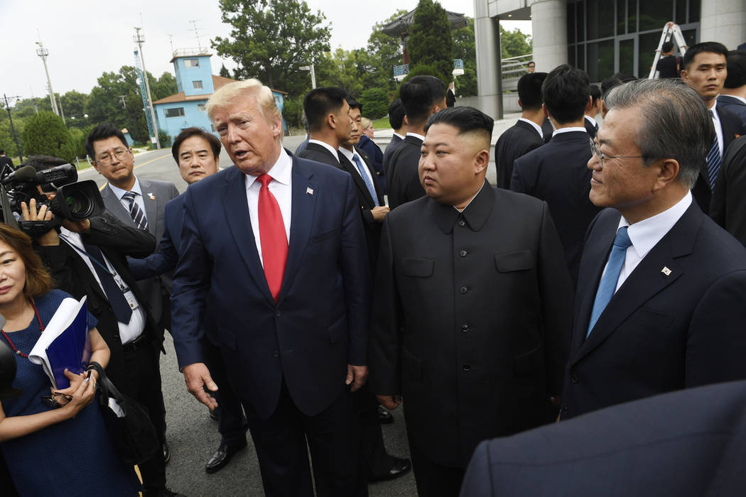 President Donald Trump meets with North Korean leader Kim Jong Un, with South Korean President ...