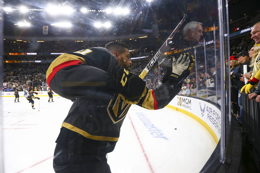Golden Knights center Pierre-Edouard Bellemare (41) slams into the glass during warmups before ...