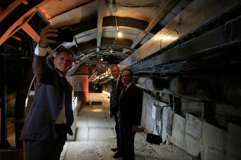 People take selfies inside an ancient tunnel during the opening of an ancient road at the City ...