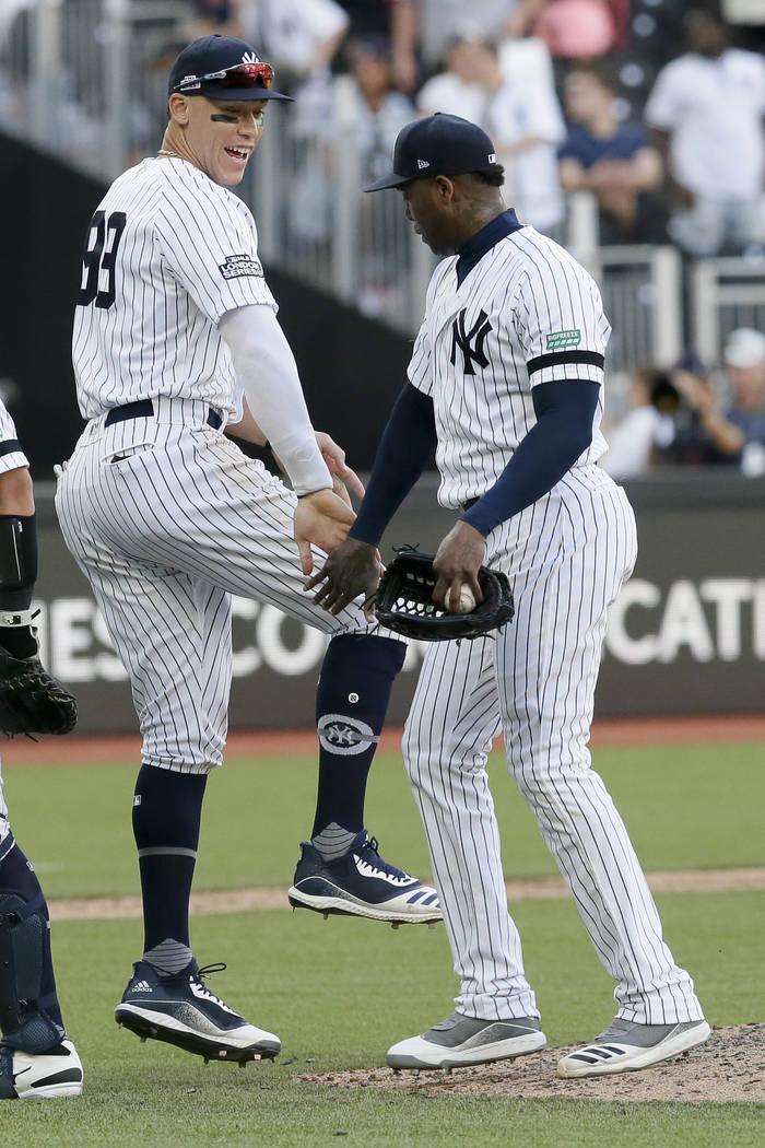 New York Yankees right fielder Aaron Judge, left, and relief pitcher Aroldis Chapman celebrate ...