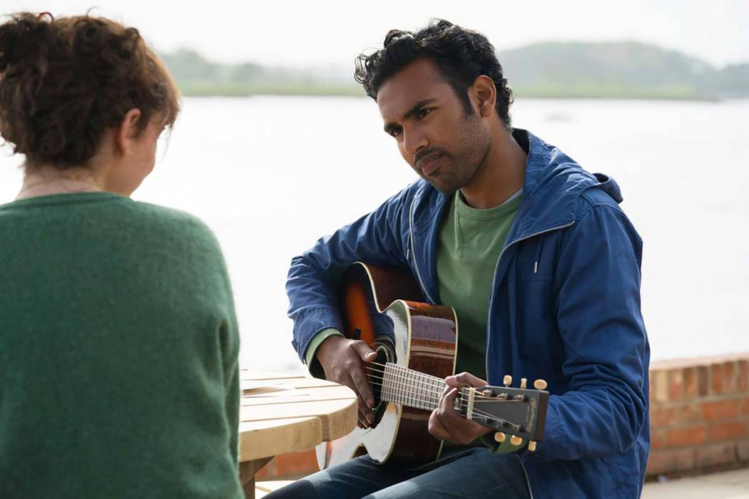 This image released by Universal Pictures shows Lily James, left, and Himesh Patel in a scene f ...