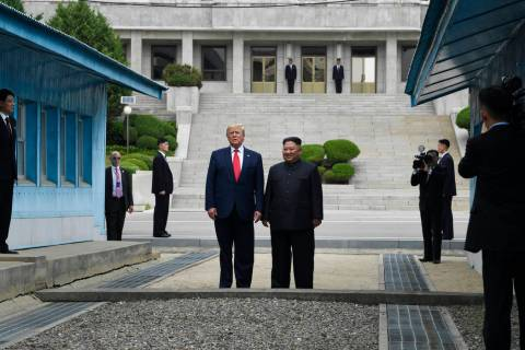 President Donald Trump and North Korean leader Kim Jong Un stand on the North Korean side in th ...