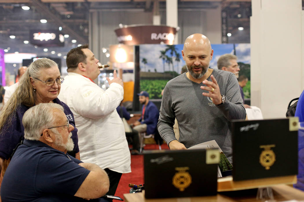 Luciano Meirelles, founder of A.C.E. Prime, right, speaks to customers Dave and Jan Mazy at the ...