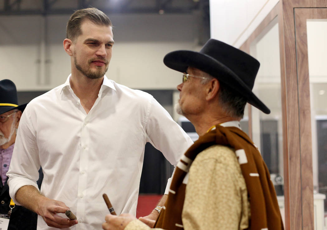 Tiago Splitter, former NBA player, speaks to Mike Bieket at the A.C.E Prime cigar booth at the ...