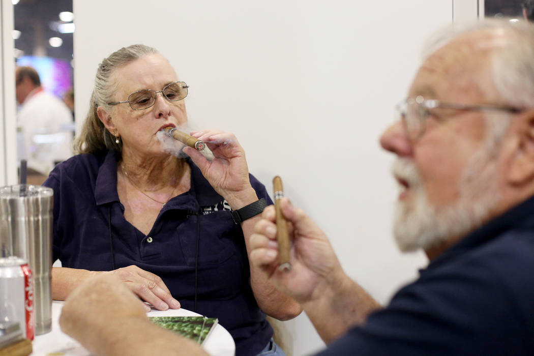 Jan and her husband Dave Mazy try out cigars at the International Premium Cigar & Pipe Reta ...