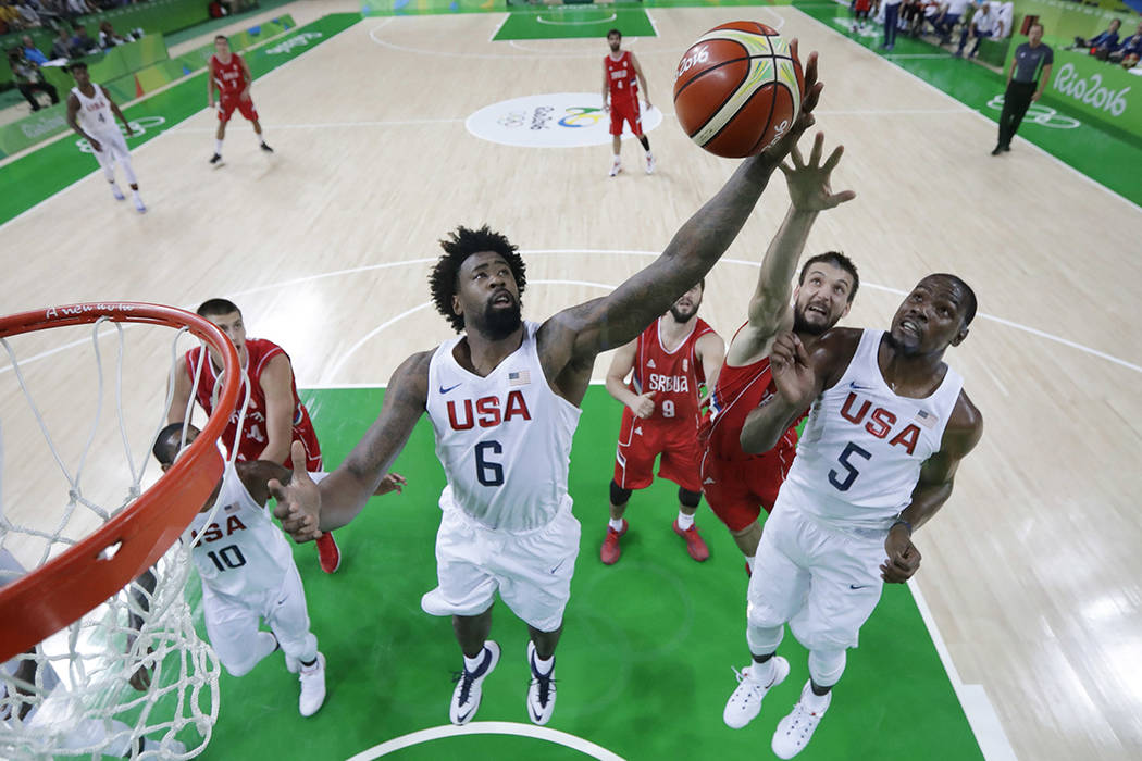 FILE - In this Aug. 12, 2016, file photo, United States' DeAndre Jordan (6), Kevin Durant (5) a ...
