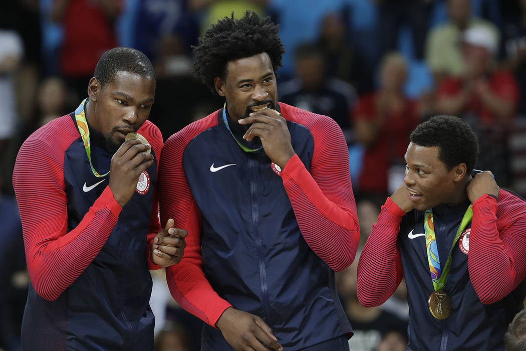 From left, United States' Kevin Durant, DeAndre Jordan and Kyle Lowry pose with their gold meda ...