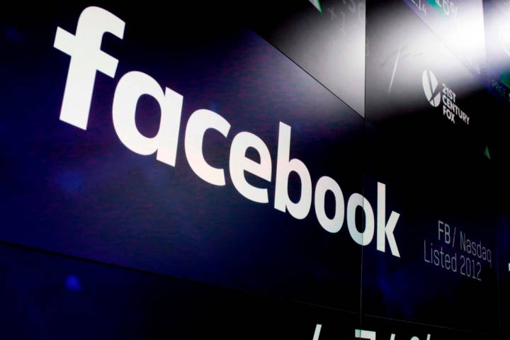 FILE - This March 29, 2018 file photo shows the Facebook logo on screens at the Nasdaq MarketSi ...