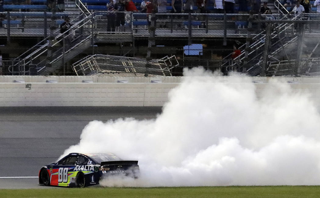 Alex Bowman burns out after winning the NASCAR Cup Series auto race at Chicagoland Speedway in ...