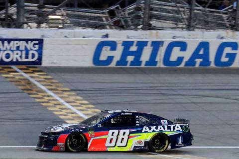 Alex Bowman crosses the finish line to win the NASCAR Cup Series auto race at Chicagoland Speed ...