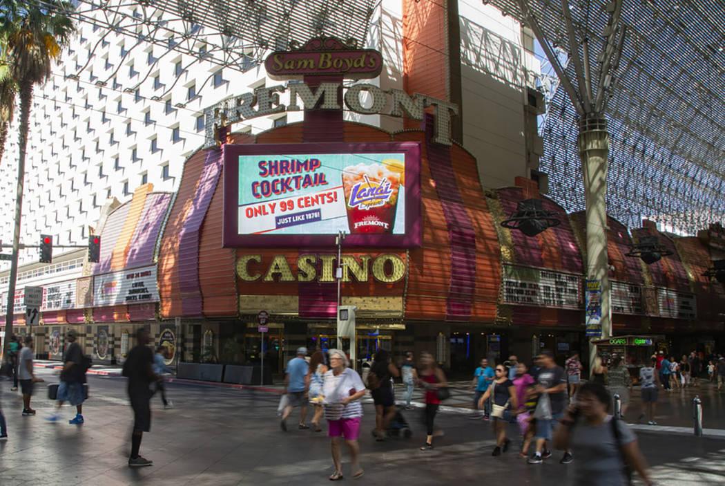 People walk by the Fremont Casino in Las Vegas, Wednesday, June 12, 2019. (Michael Blackshire/L ...