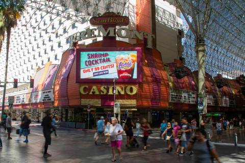 People walk by the Fremont Casino in Las Vegas, Wednesday, June 12, 2019. (Michael Blackshire/L ...