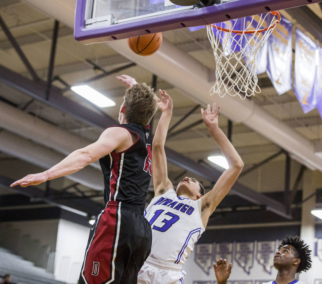 Durango's Anthony Swift (13) attempts a layup against Desert Oasis defender Jacob Hees ...
