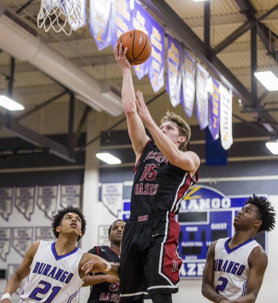 Desert Oasis' Jacob Heese (15) attempts a layup while Durango's Anthony Hunter ( ...
