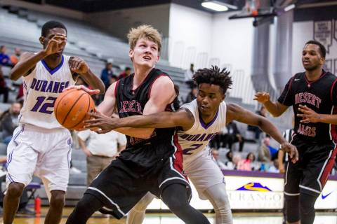 Desert Oasis' Jacob Heese (15) looks for a shot as Durango's Drake Booker (2) tr ...
