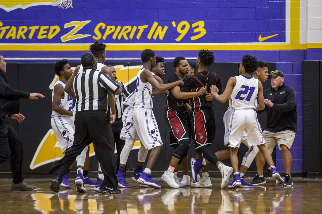 A fight breaks out between Desert Oasis and Durango at Durango High School on Thursday, Jan. ...