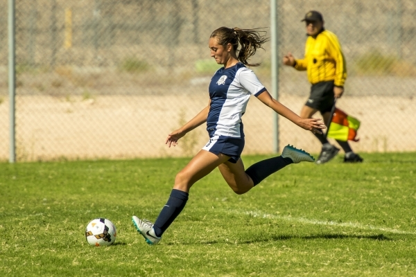 Katherine Ballou (6) of the Foothill Falcons kicks the ball downfield against the Silverado ...
