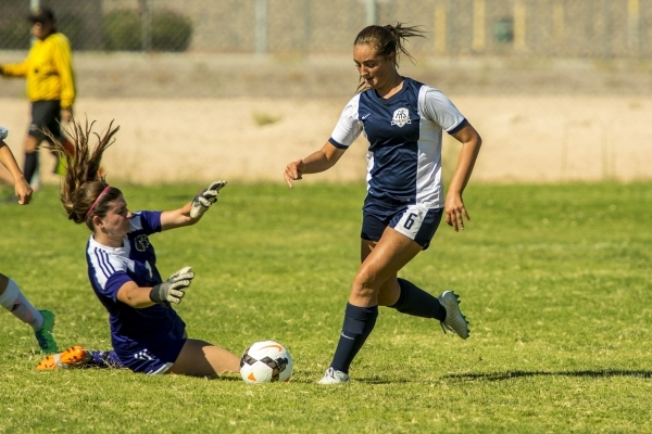Katherine Ballou (6) of the Foothill Falcons takes the ball past Mikaila Becze of the Silver ...