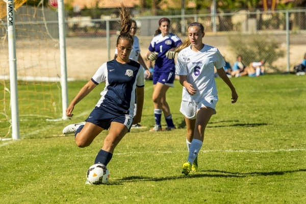 Katherine Ballou (6) of the Foothill Falcons passes the ball to a teammate as Brynna McGinni ...