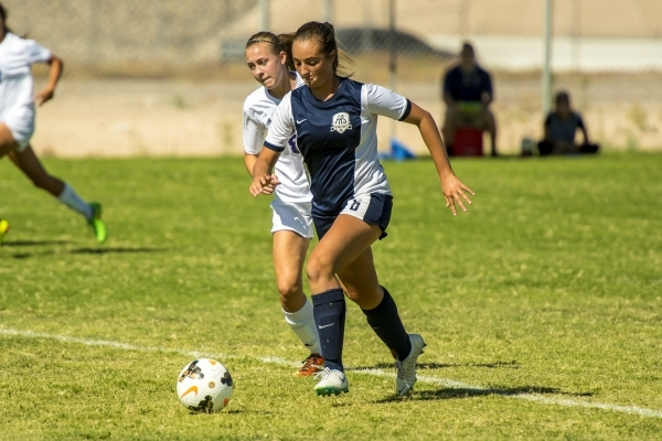 Katherine Ballou (6) of the Foothill Falcons takes the ball past Kayla McGinnis of the Silve ...