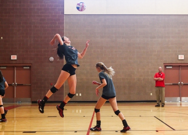 Arbor View outside hitter Hannah Goddard, left, jumps to serve the ball during volleyball pr ...